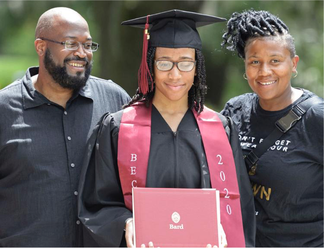 Student and family smiling on graduation day